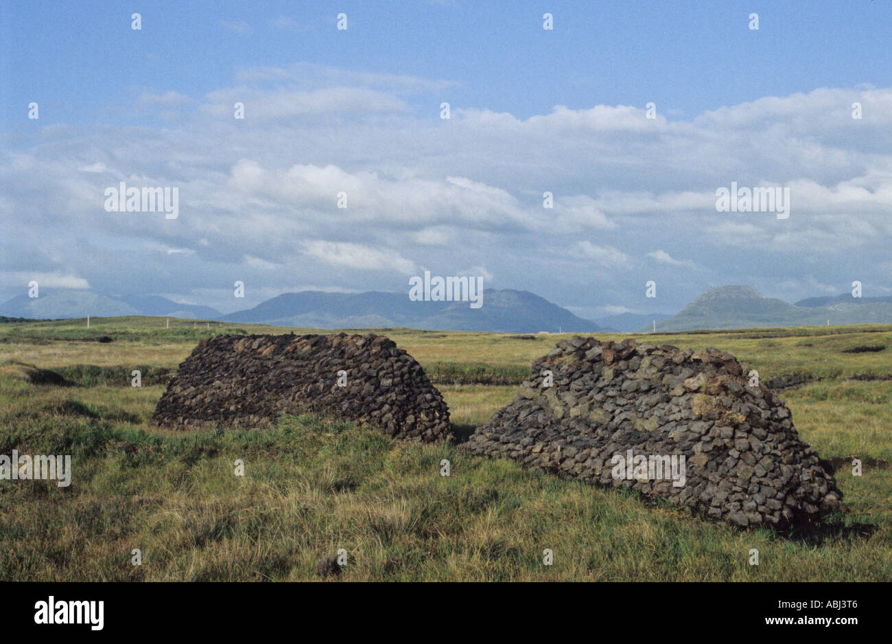 Piles of turf, Connemara, County Galway, Republic of Ireland Stock Photo