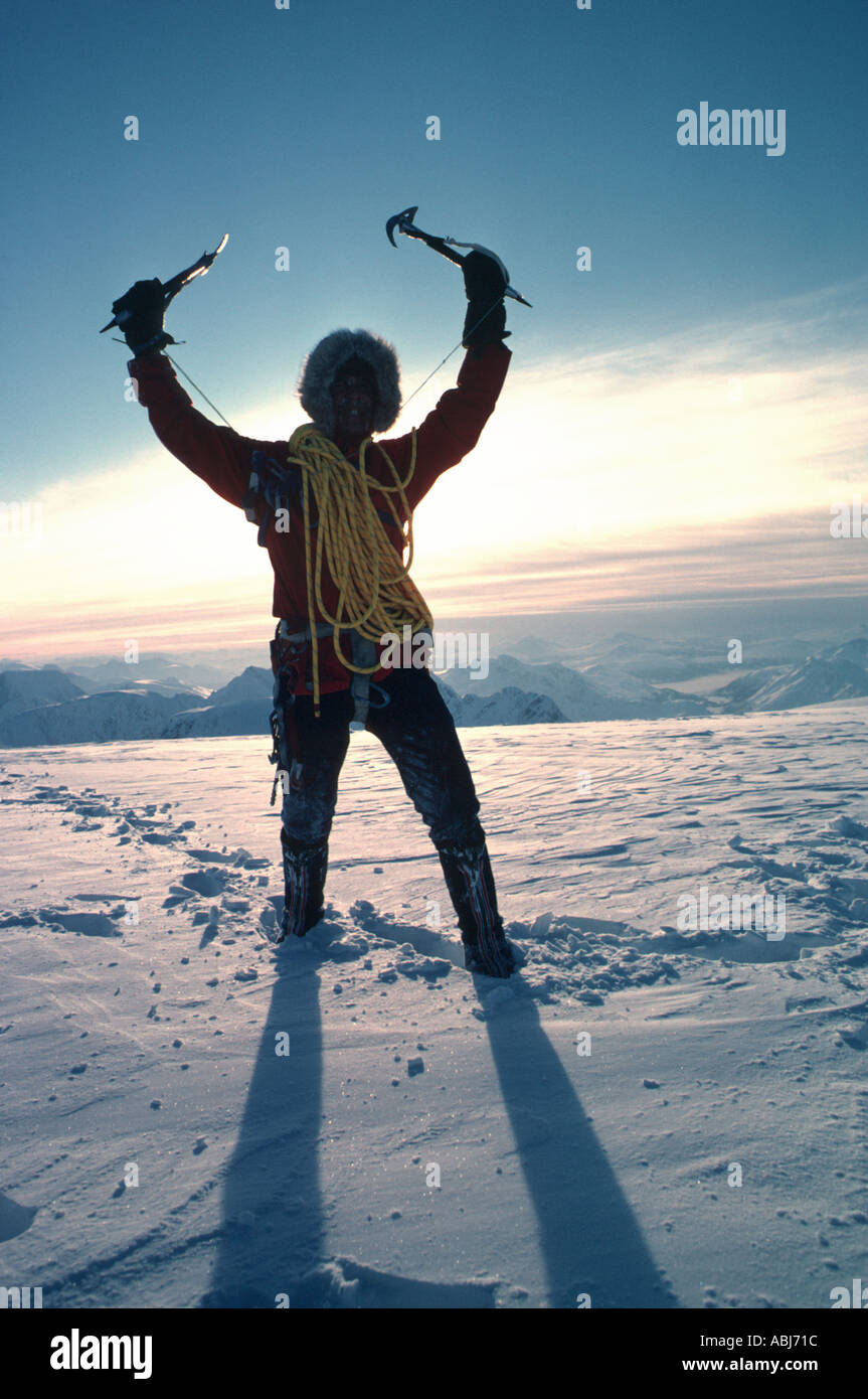 Mountain climber at the summit - Stock Image