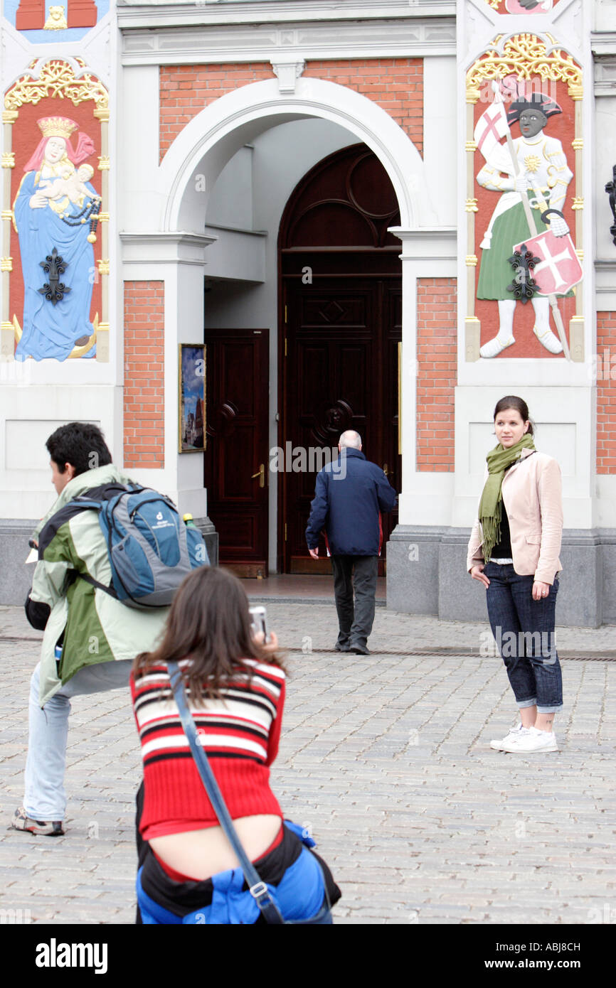 Tourists take pictures in front of House of Blackheads in Riga, Latvia - Stock Image