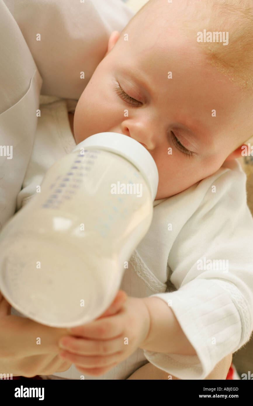 Baby being bottle fed - Stock Image