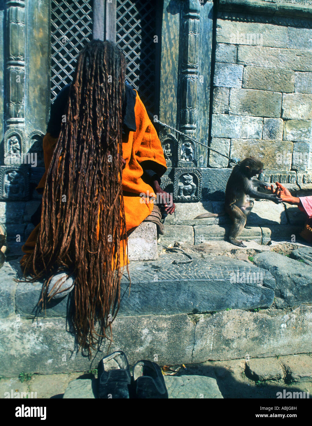 One of the many Shamens outside a Hindhu temple in central Kathmandhu Nepal - Stock Image