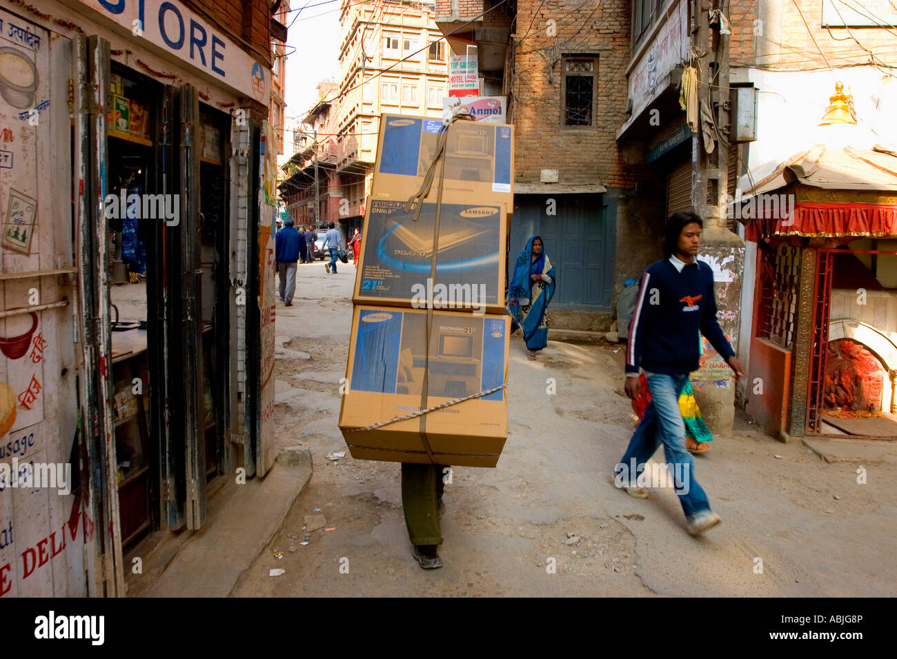 TV's beind delivered to a shop in Durbar Square in Kathmandhu. - Stock Image