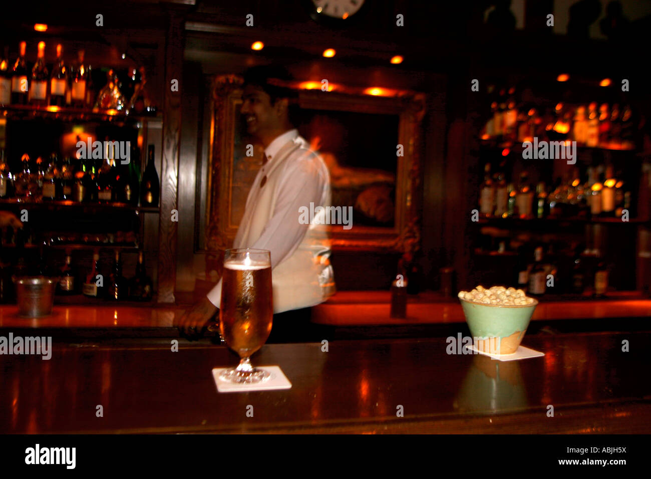 The Long Bar at the nineteenth century hotel Raffles in Singapore - Stock Image
