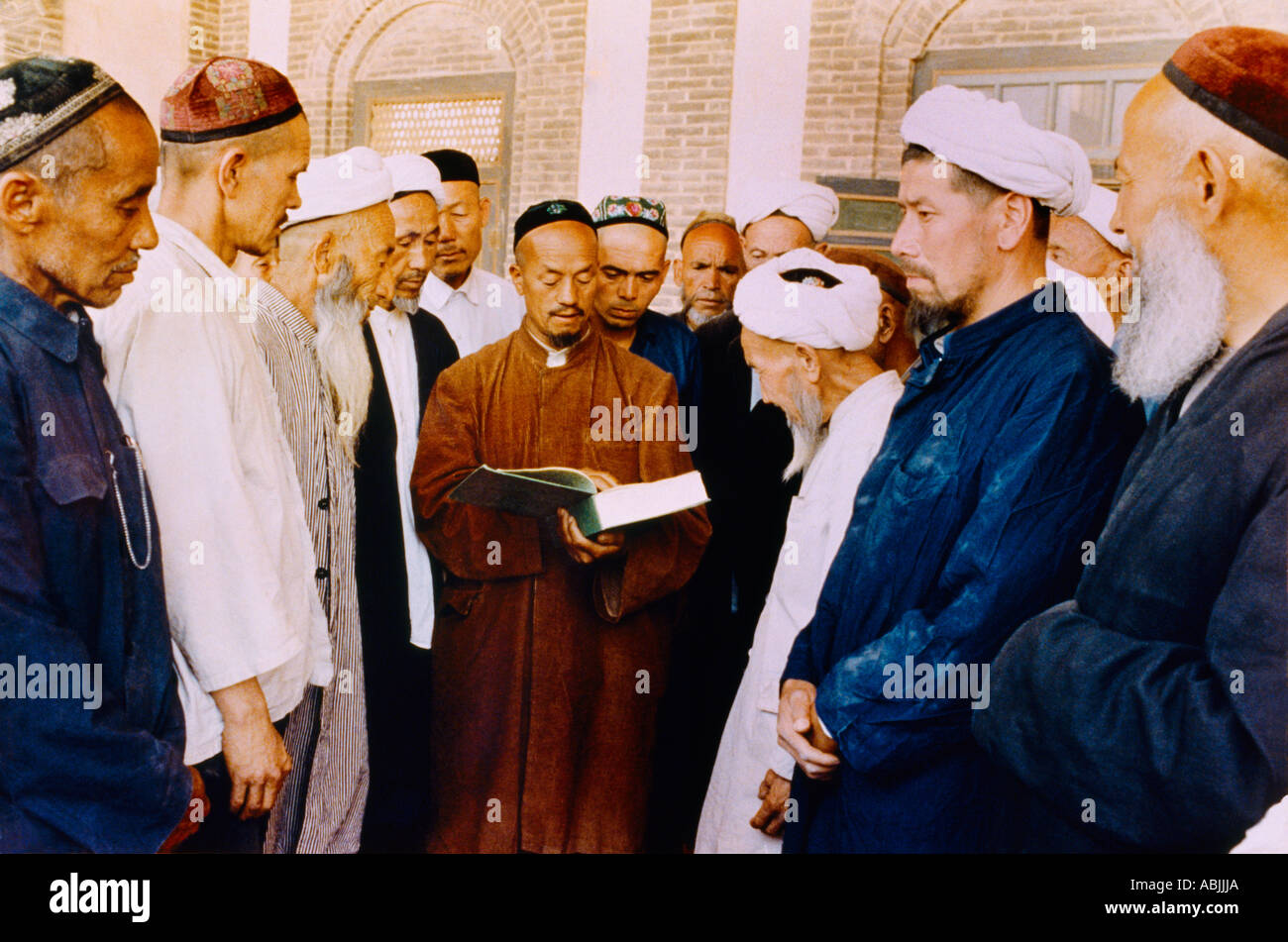 Kashi Xinjiang China Uygur Muslims Imam Reading From Quran In Mosque - Stock Image