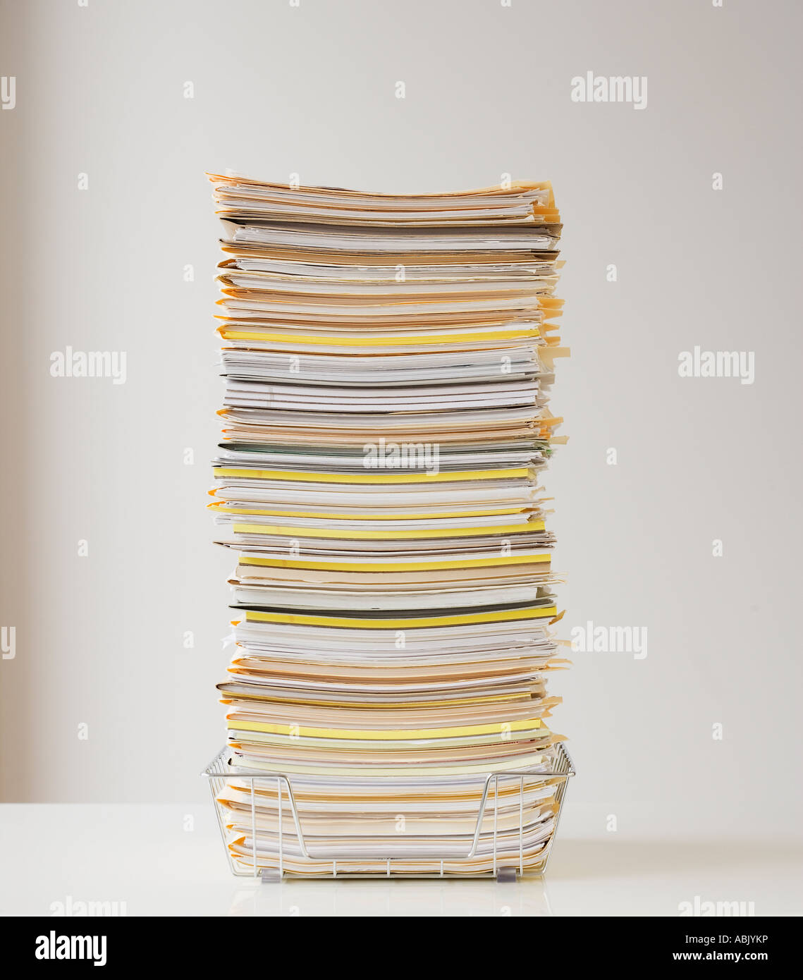 Large stack of paperwork in wire basket Stock Photo: 12910809 - Alamy