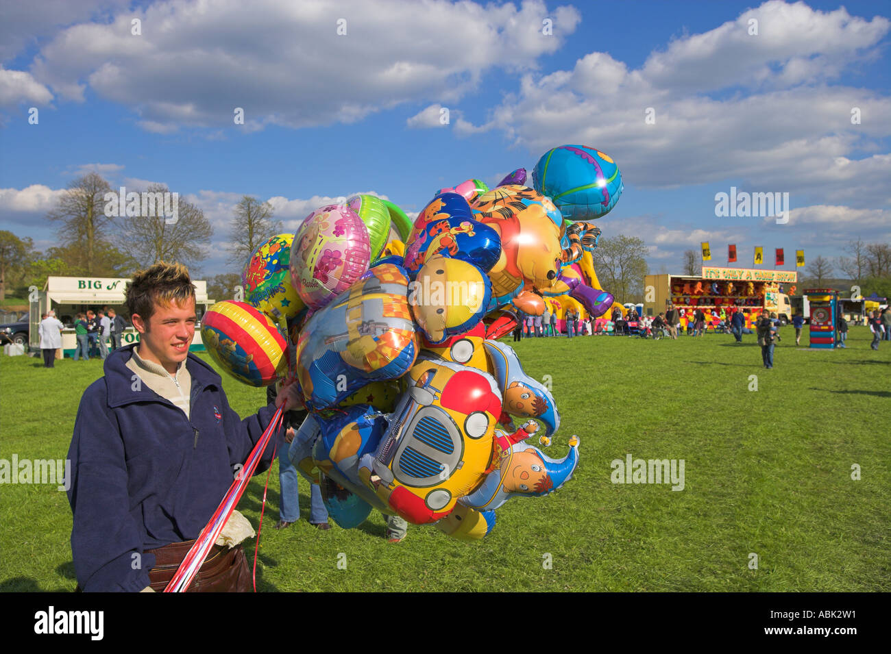 Balloon seller at local event - Stock Image