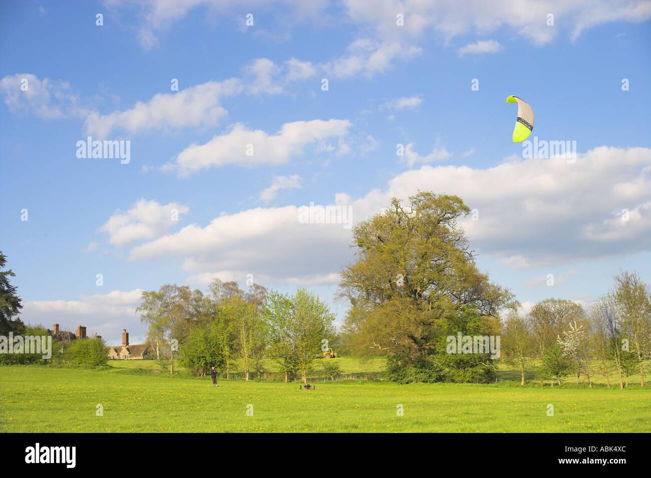 Man flying kite setting up for landboarding buggie - Stock Image