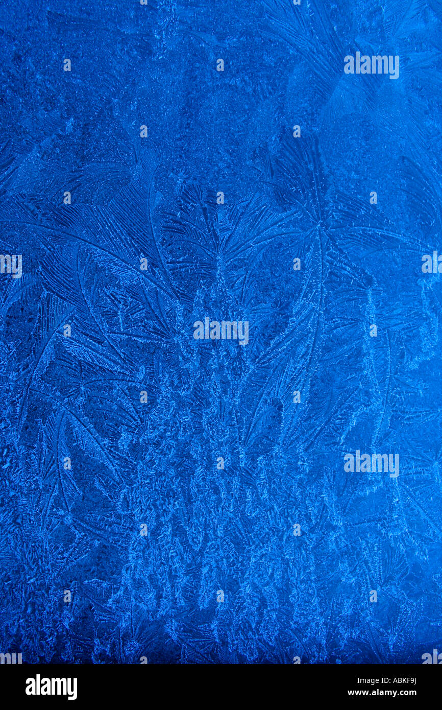 Icey frost on blue car - Stock Image