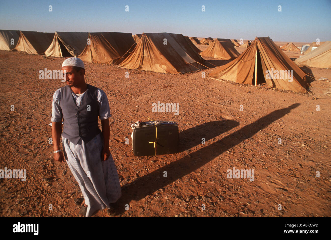 A refugee from the Iraqi War arrives at a tented camp in Jordan. - Stock Image
