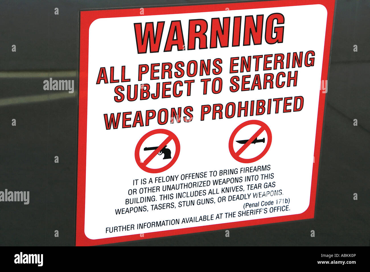 Sign warning those who enter are subject to search for prohibited weapons courthouse Downtown San Diego California - Stock Image