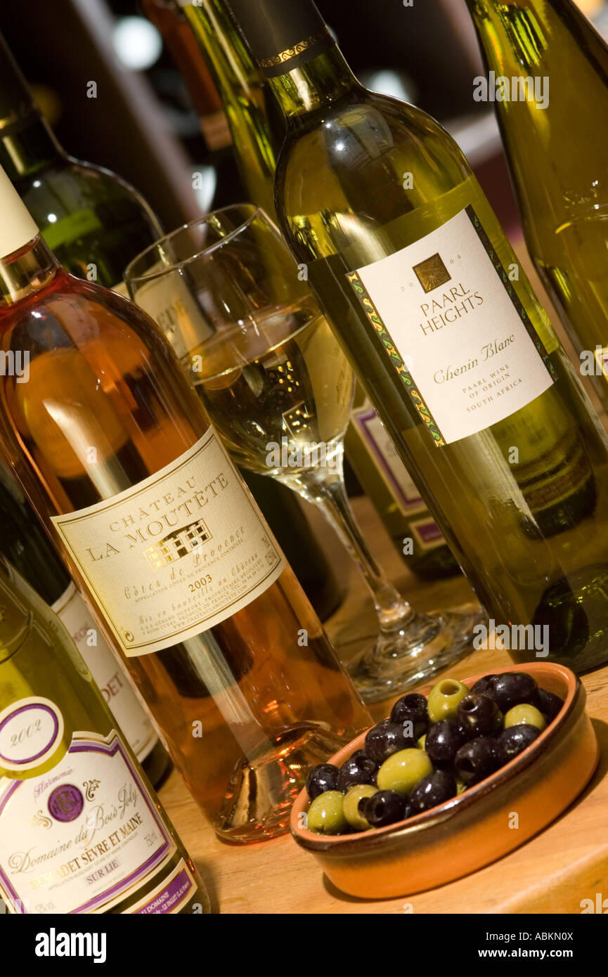 a selection of wine bottles on a table for drinking with a bowl of ...