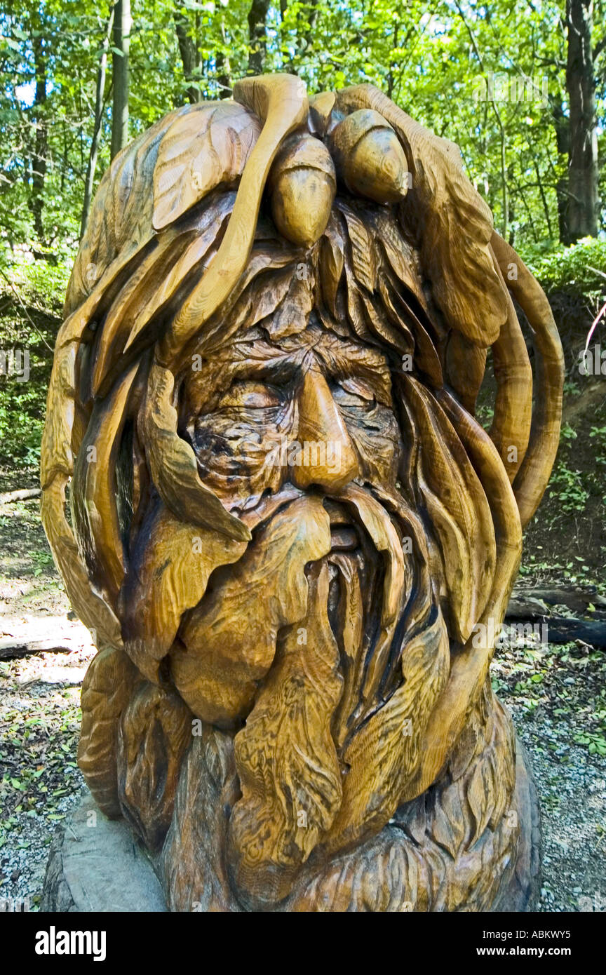 Wood carving of the green man on the sculpture trail at the crich