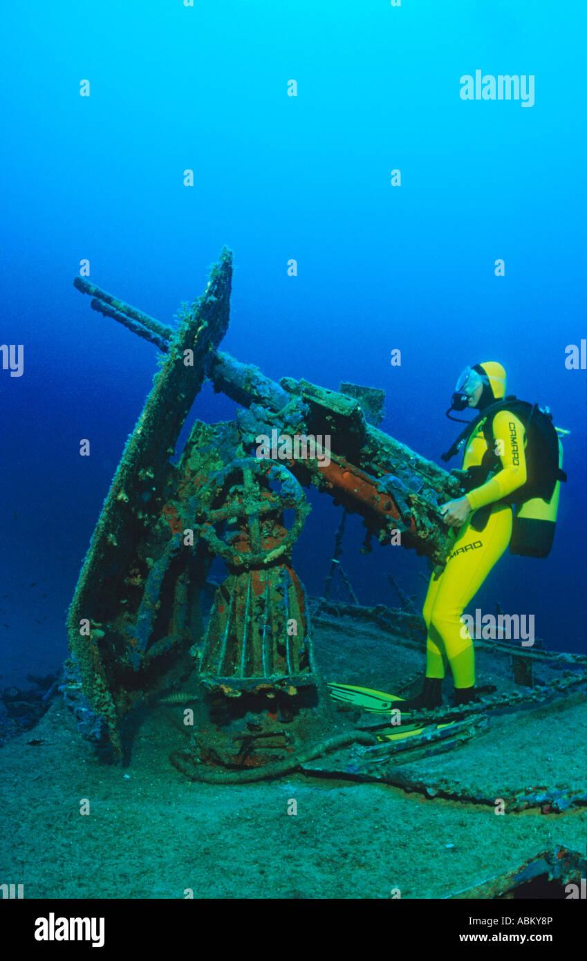 scuba diver at the gun of a gun shipwreck 'S 57' in Kroatia - Stock Image