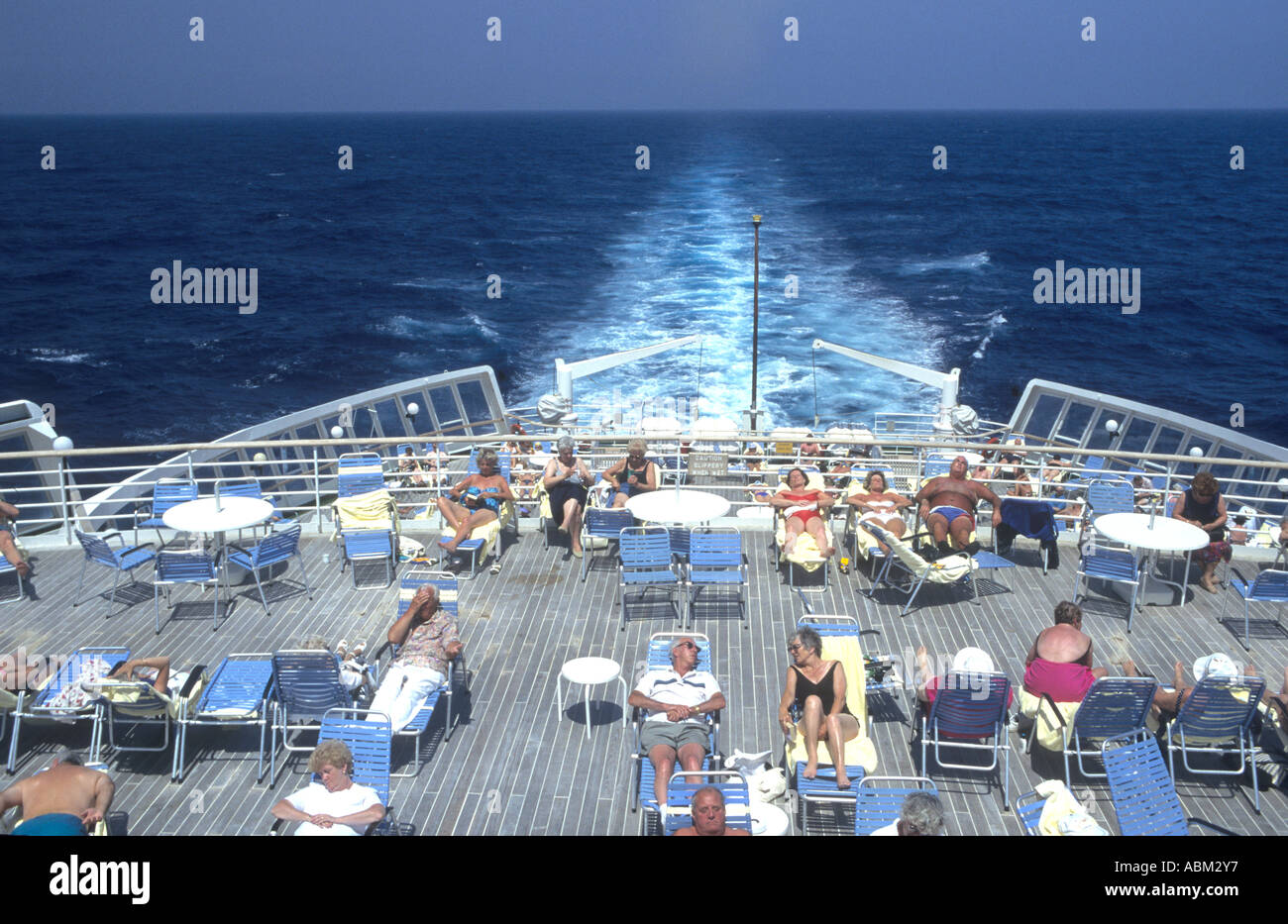 Passengers Relaxing on the sundeck of the cruise ship QE2 - Stock Image
