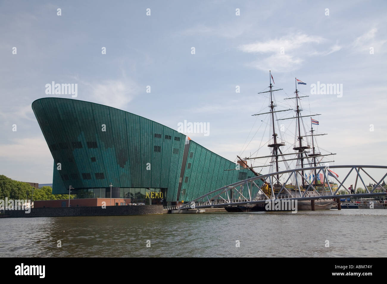 Nemo and replica of Dutch East India Company Boat, Amsterdam, Netherlands - Stock Image