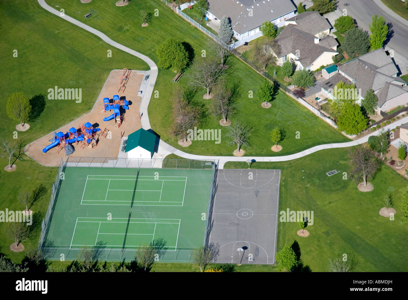 Aerial View Of A Park With Playground Equipment Tennis