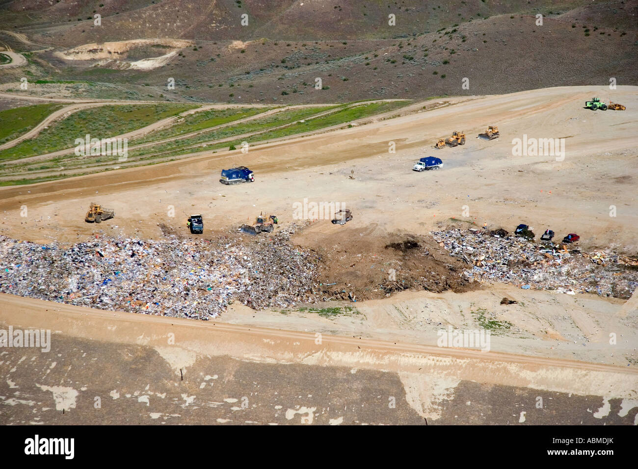 Aerial view of trucks and tractors working at the sanitary landfill in Boise Idaho - Stock Image