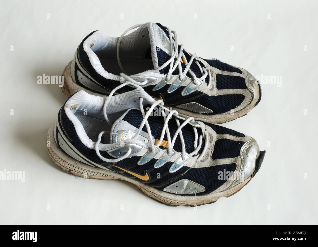 An old pair of Nike running shoes Stock