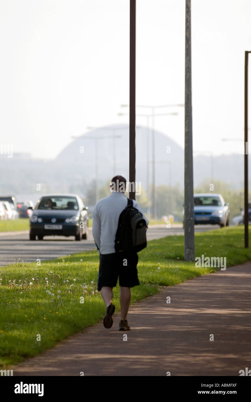 man walking towards Central Milton Keynes road snow dome UK cars driving Central Milton Keynes, the Centre MK - Stock Image
