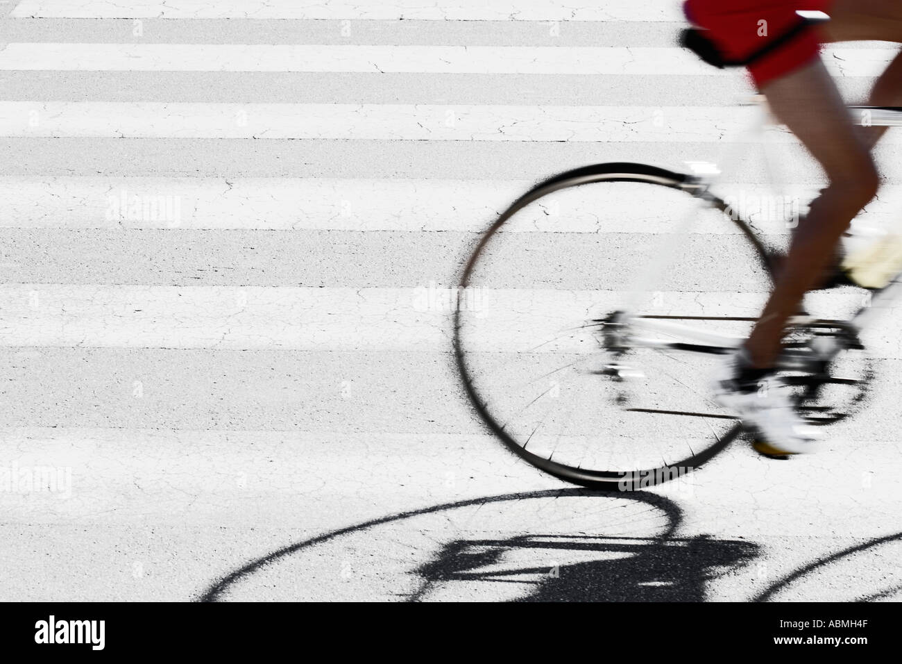 Bicycle Rider At Crosswalk - Stock Image