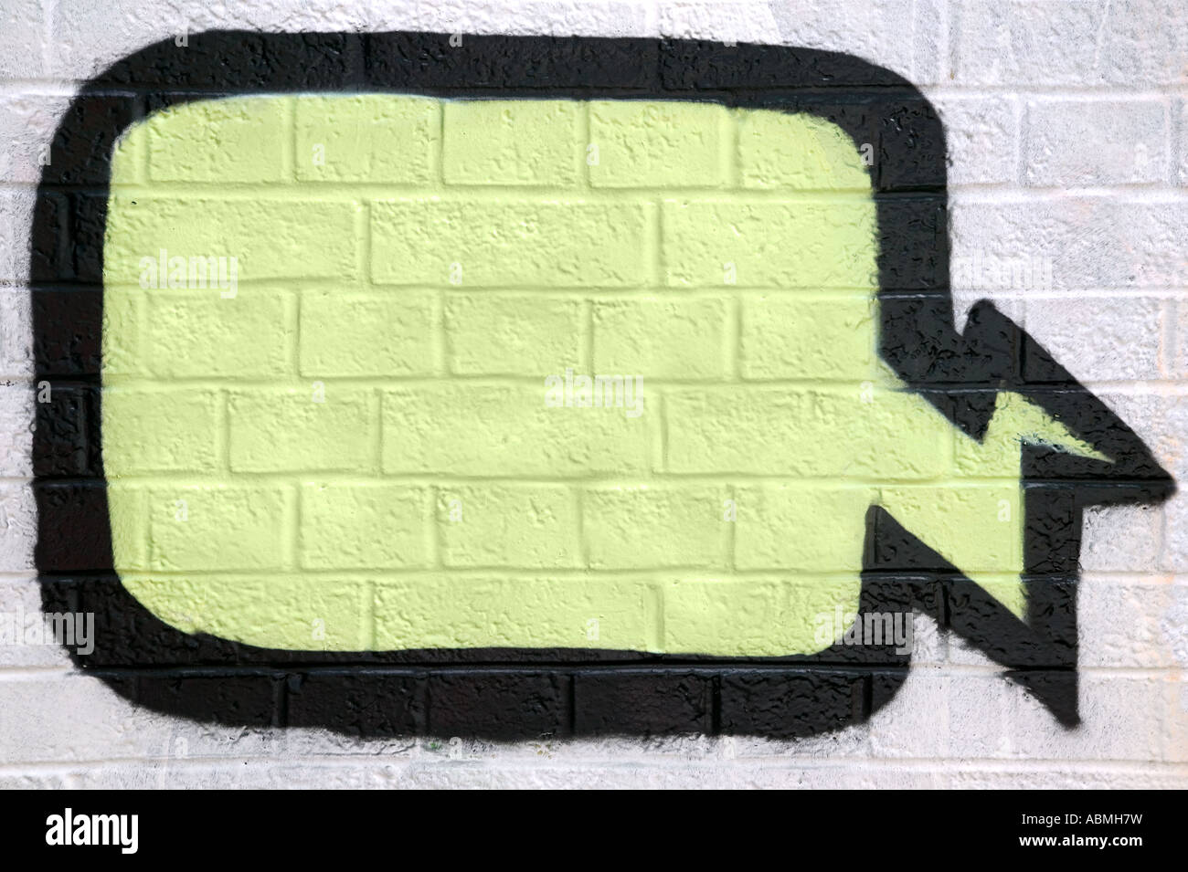 Graffiti thought bubble sprayed on a brick wall enter your own text - Stock Image