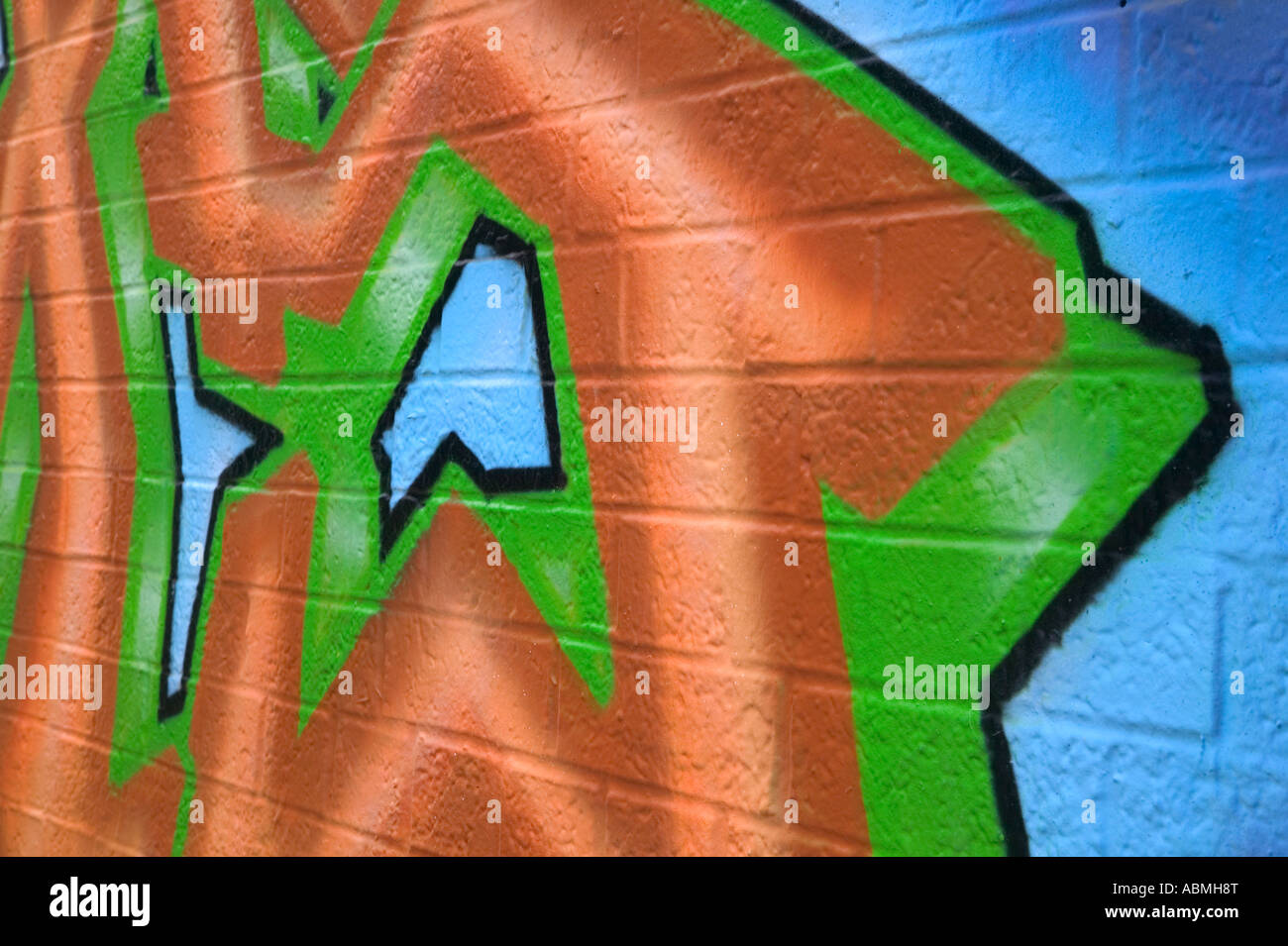 Graffiti sprayed on the brick wall of an abandoned building - Stock Image