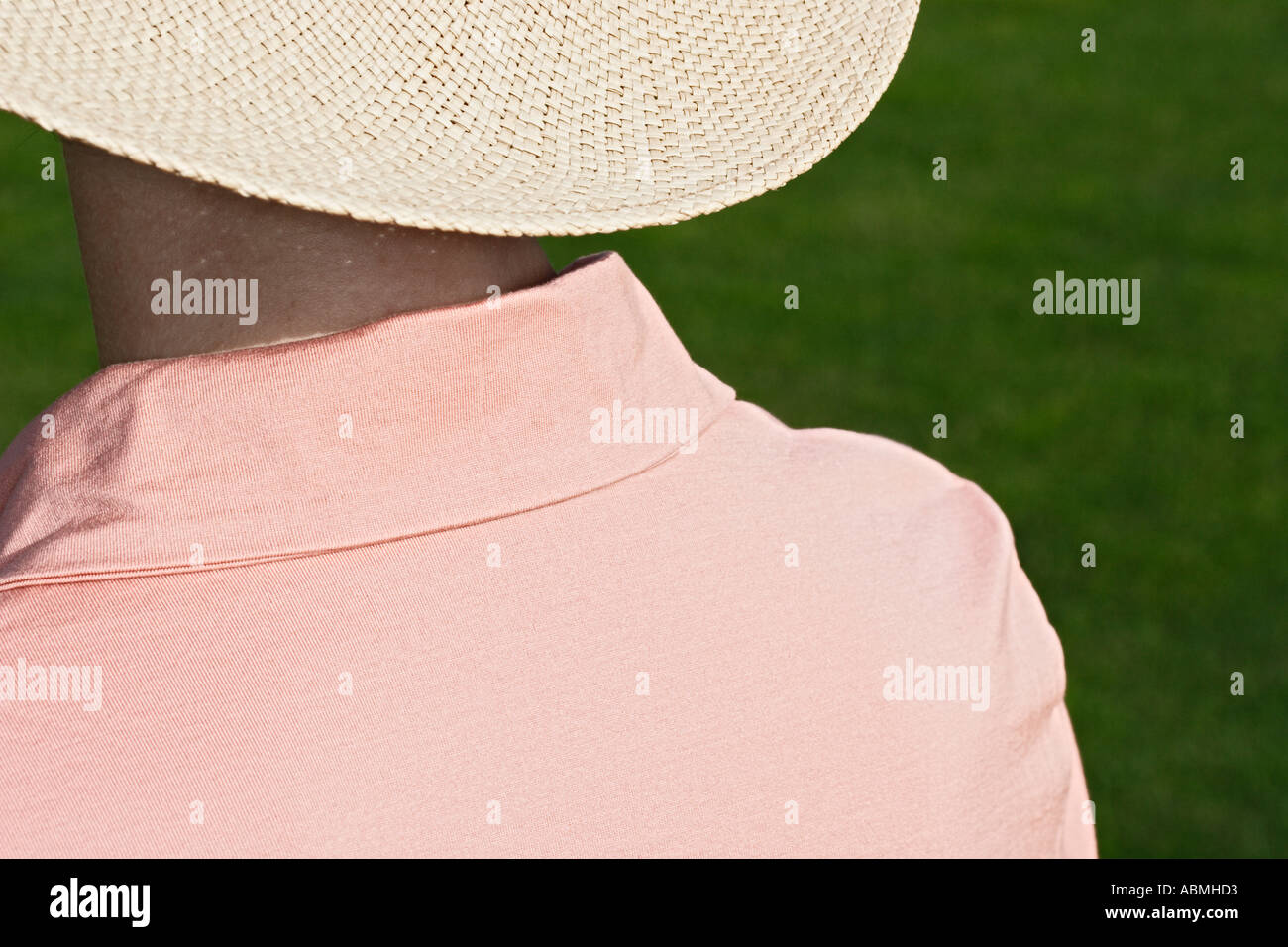 Woman Wearing Straw Hat In The Sun Stock Photo