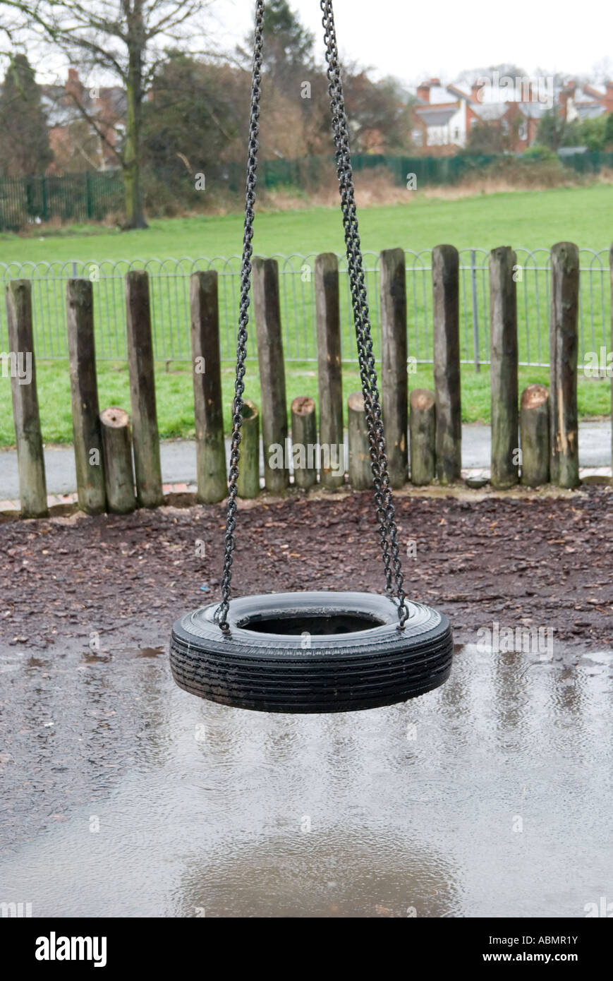 A Car Tyre Swing In A Playground In A Park In A Rainy Day Stock Photo Alamy