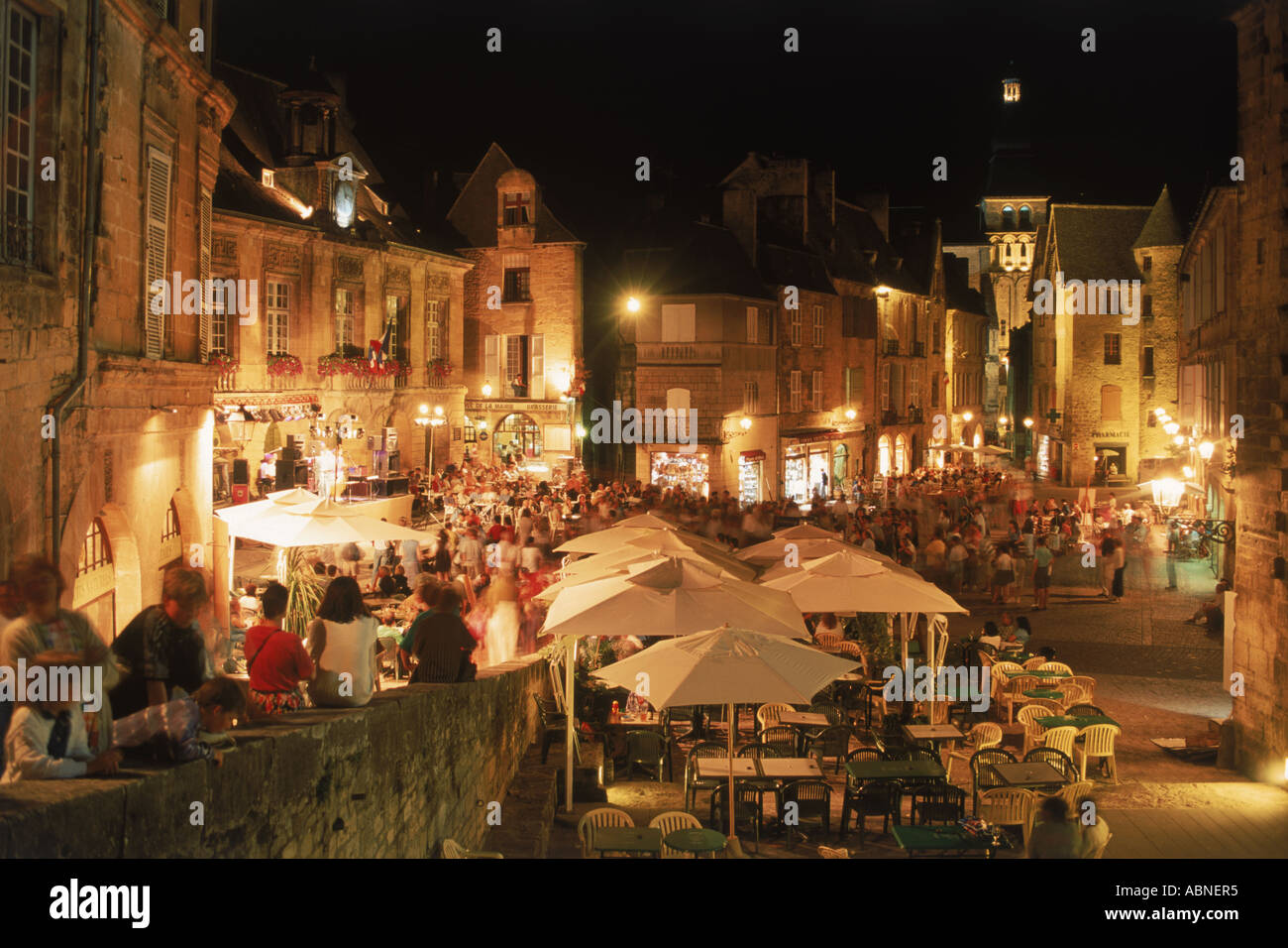 Open air markets and restaurants on Place de la Liberte at Old Town of Sarlat Perigord Noir in Dordogne France Stock Photo