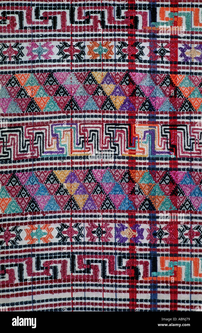 Bhutanese brocaded fabric with silk brocading Woven on a hip strap loom Bhutan - Stock Image