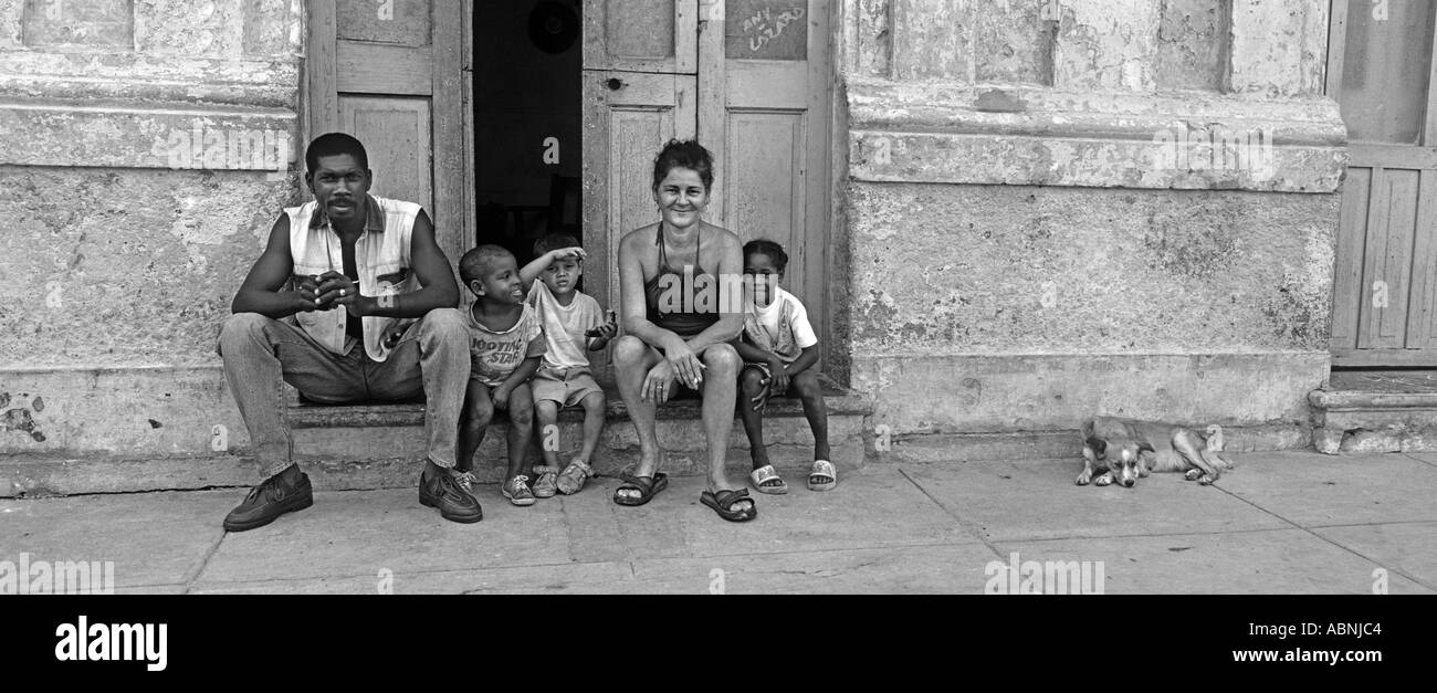 Cuban family seated outside their home Cubans are friendly and welcoming people Cardenas or possibly Havana Cuba Stock Photo