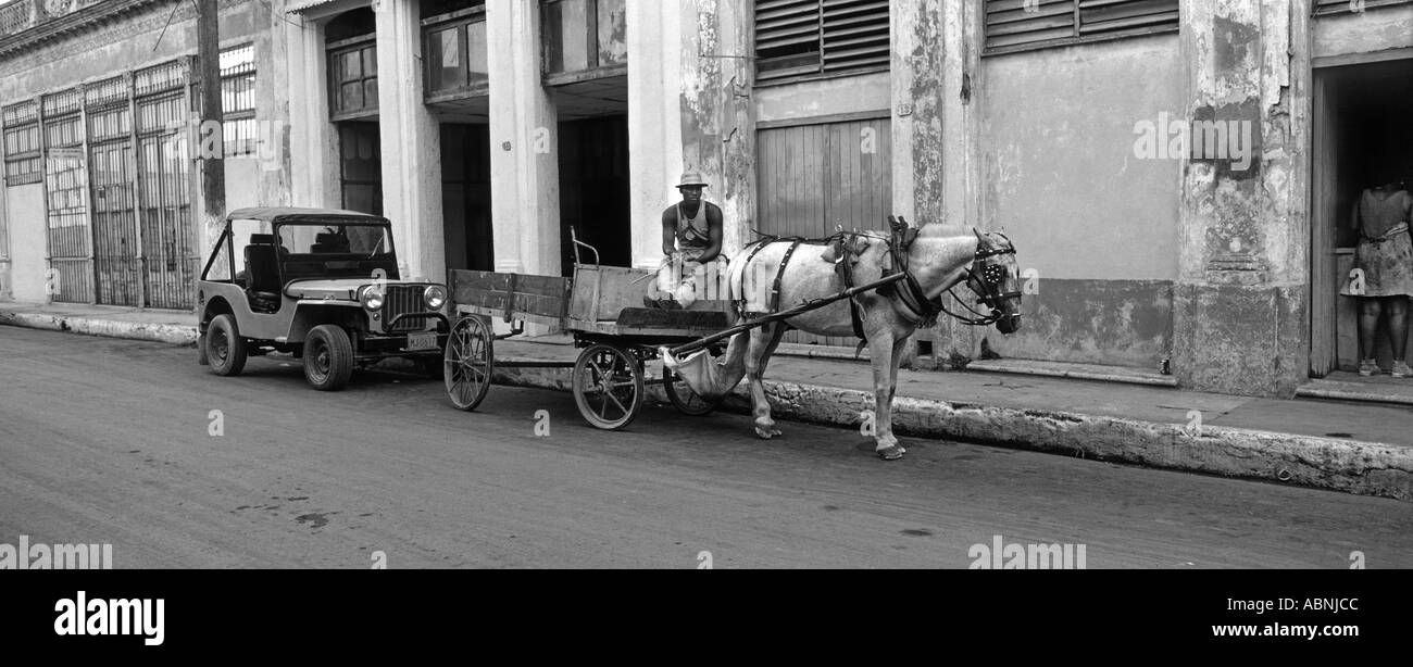 Horse and cart parked next to a jeep Cardenas Cuba - Stock Image