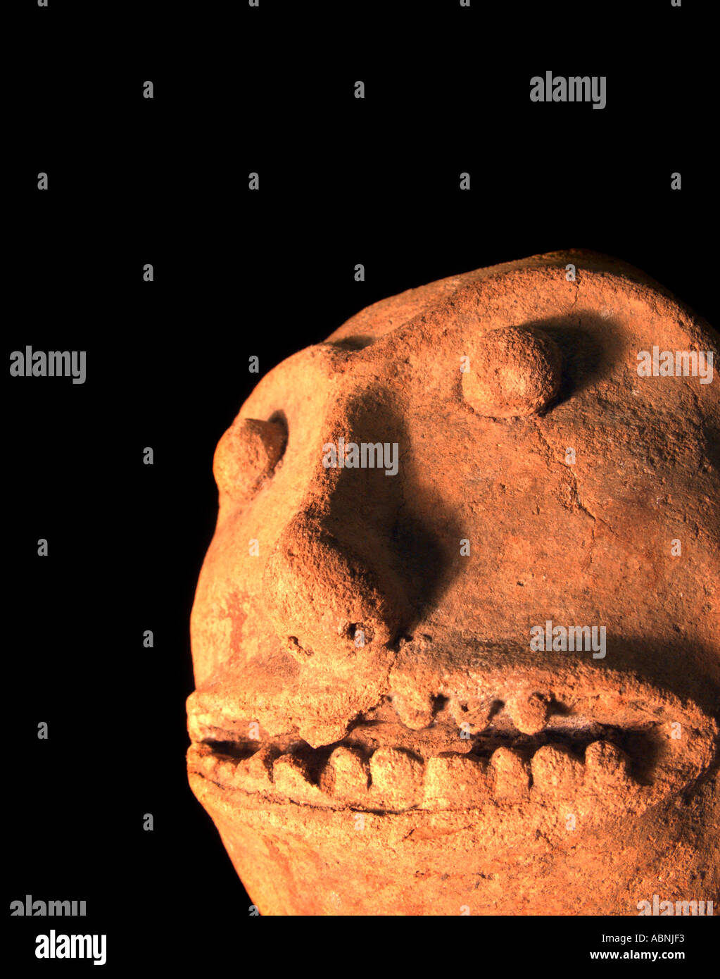 Precolumbian Maya ceramic figurine from Guatemala Demonic features on this terracotta sculpture - Stock Image