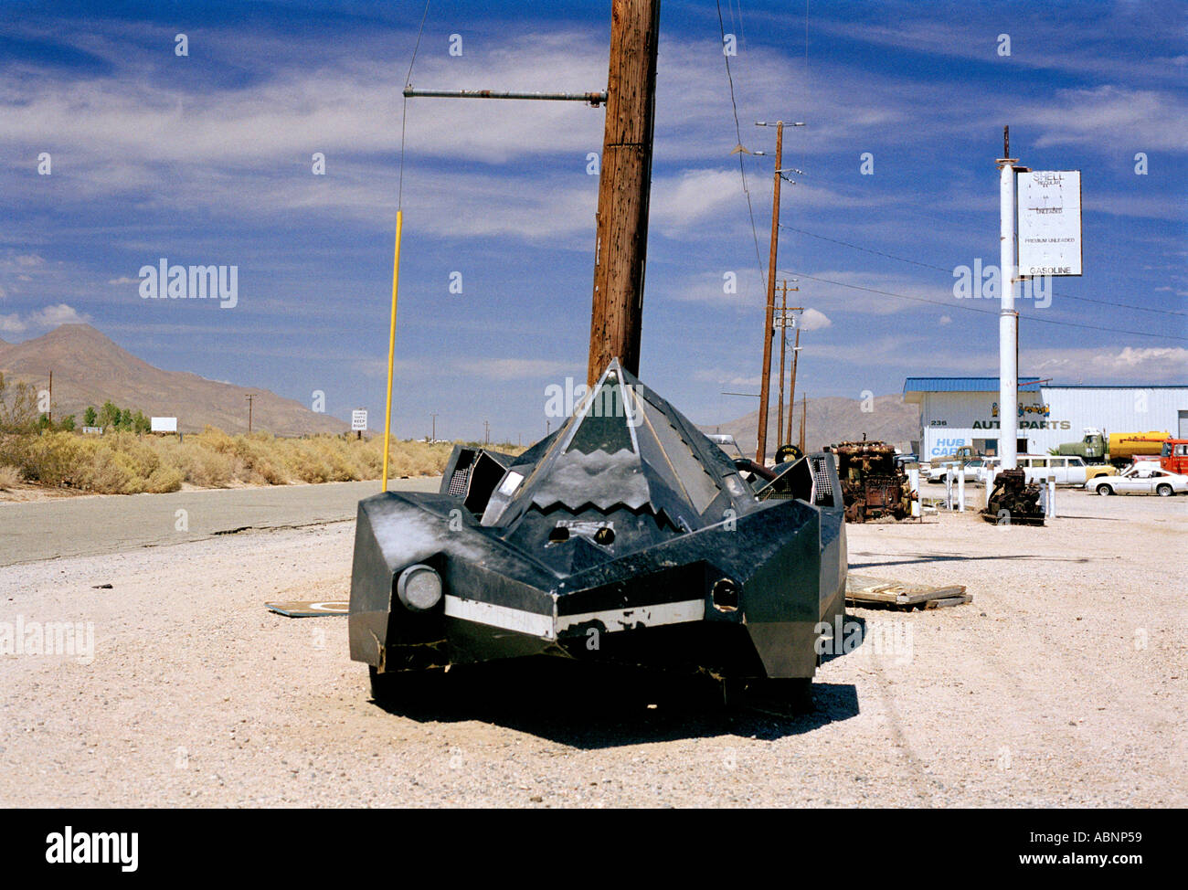 CAR LOOKING LIKE A STEALTH BOMBER CAR IN DESERT - Stock Image