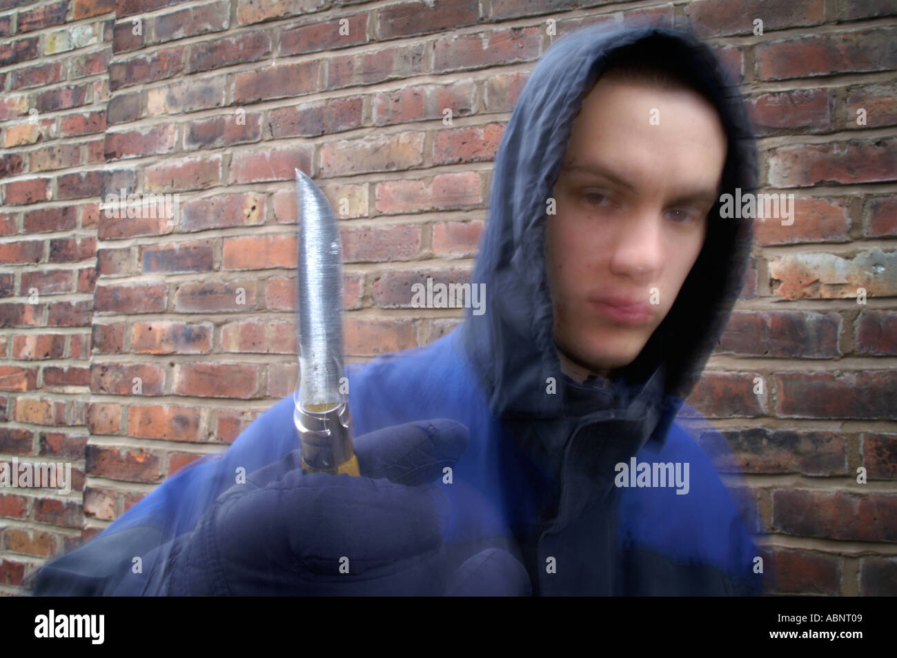 Hoody with knife 2 - Stock Image