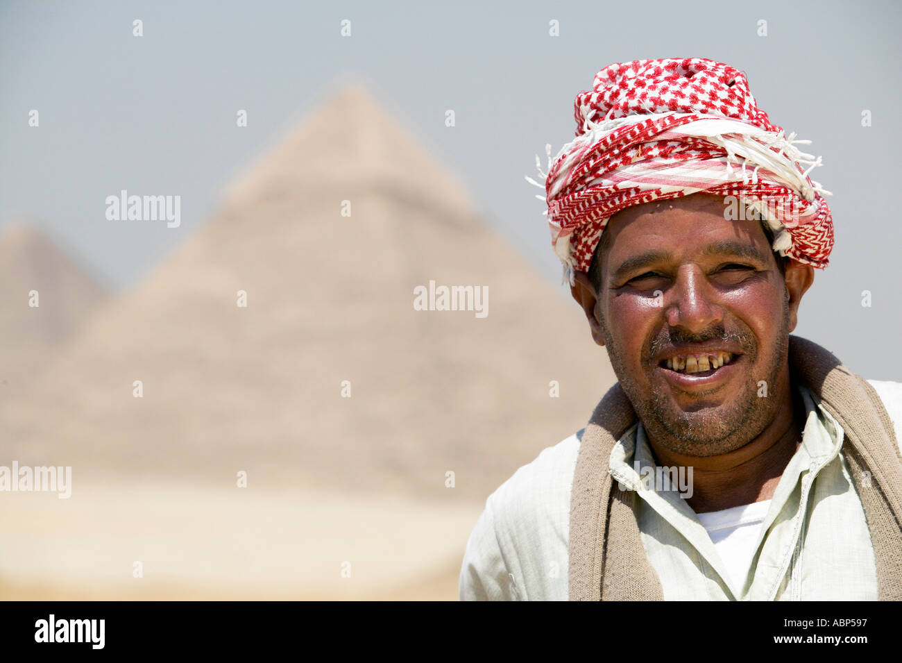 Abp597 camel and owner at giza pyramids cairo egypt model release