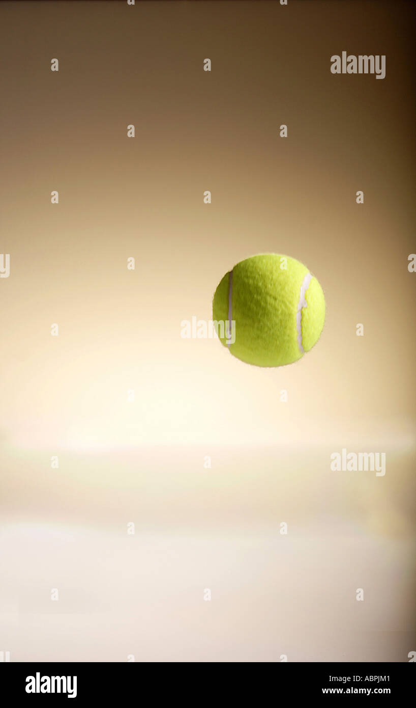 Vda78905 One Green Color Tennis Ball Bouncing In Air Stock Photo
