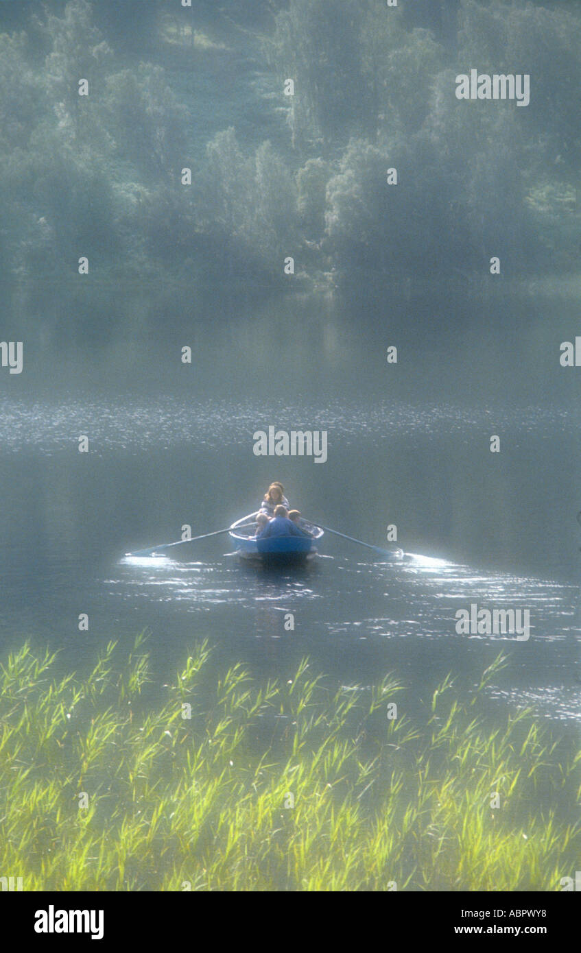 Family outing in a boat on a loch - Stock Image