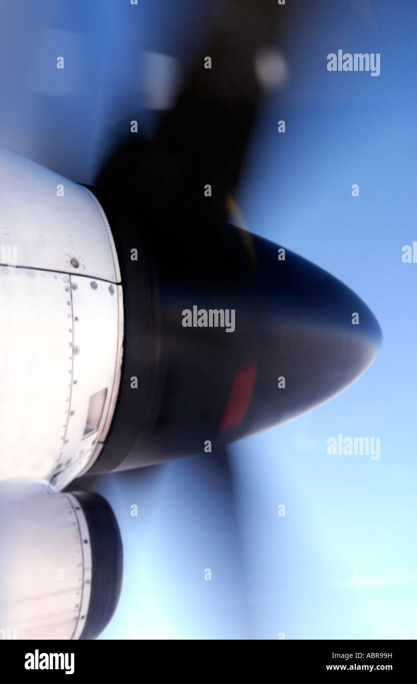 Aircraft airplane spinner and propeller. In flight turbo-prop engine. Passenger transport plane. Speed. - Stock Image