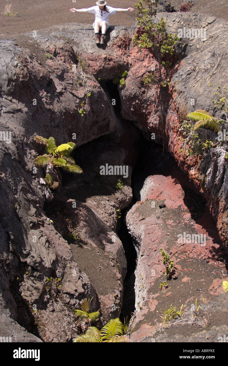 Looking into a volcanic vent, East Rift Zone, Hawai'i Volcanoes National Park - with a volcanologist for scale. - Stock Image