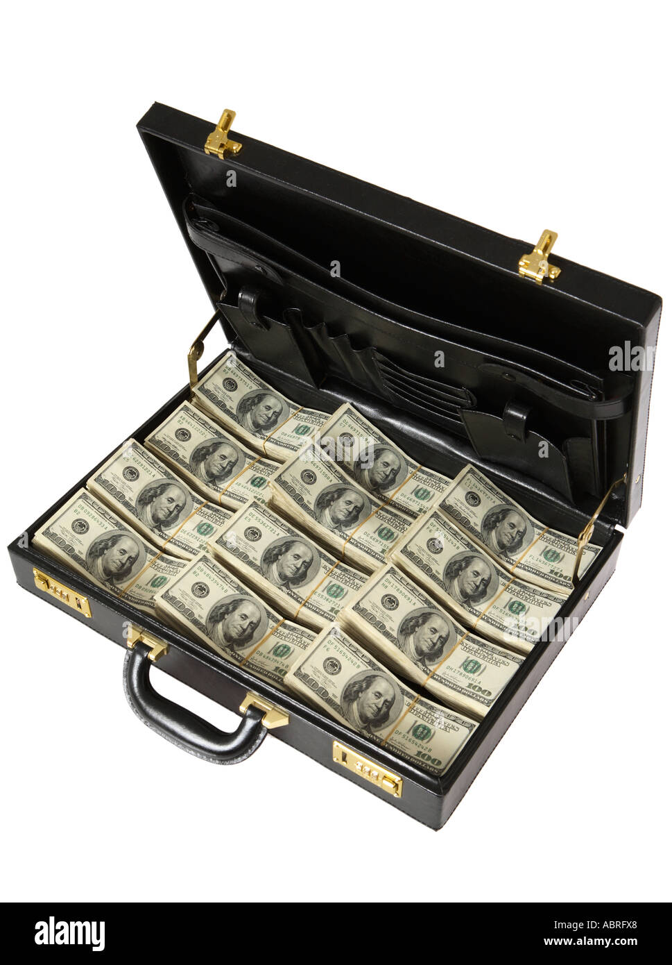 Briefcase full of stacks of one hundred dollar bills. - Stock Image