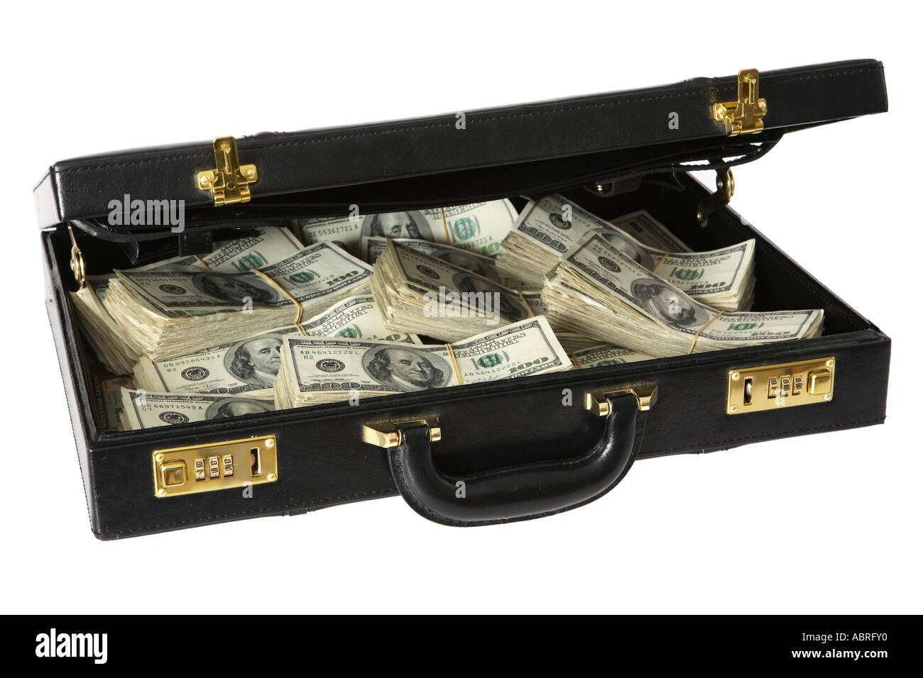 Brief case with piles of hundred dollar bills. - Stock Image