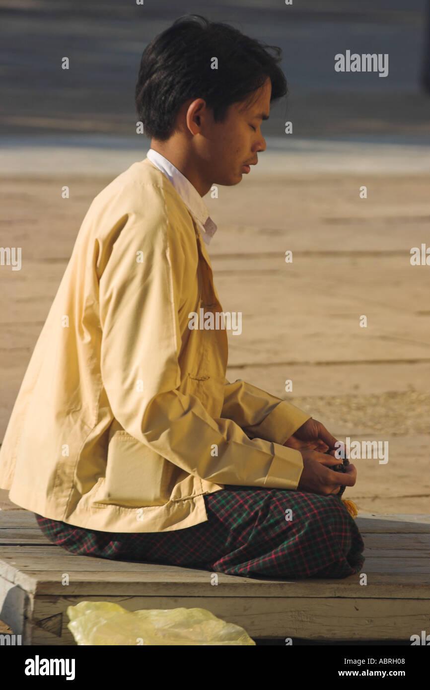 Myanmar Bagan Myothit Pilgrim praying at Lawkananda Pagoda built by King Anawrahta in 1059 A D to enshrine a Holy Tooth - Stock Image