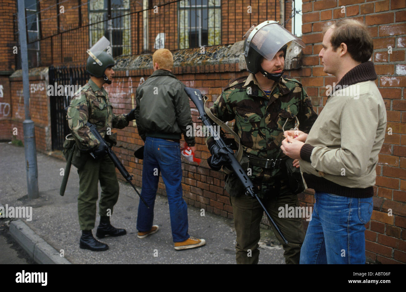 The Troubles Northern Ireland 1980s Catholic youth  British Army during the  troubles Belfast HOMER SYKES - Stock Image