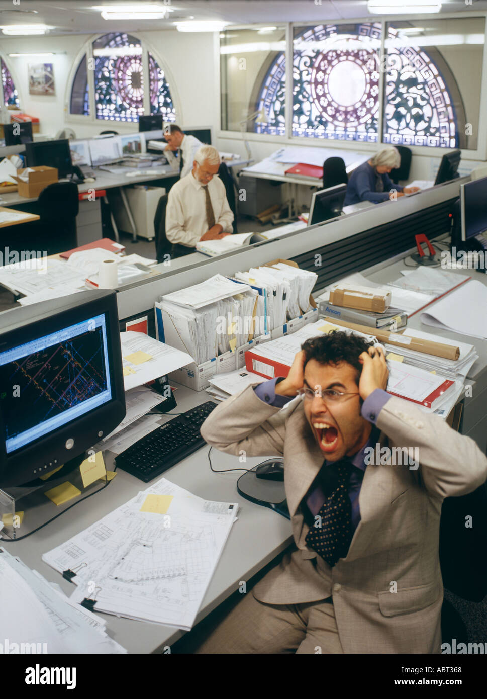 Office Life And Interiors Frustrated Office Worker Stock Photo
