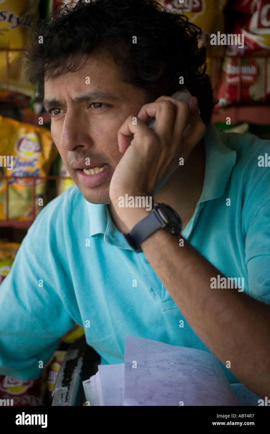Indian journalist using a mobile phone, Poona Stock Photo