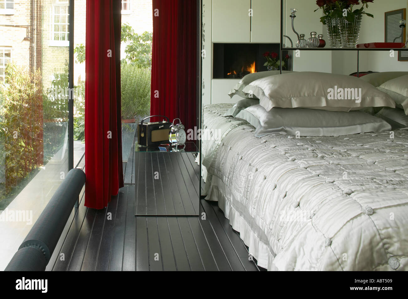 Refurbished House In Camden Town Master Bedroom With Mirrored Headboard Architect Munkenbeck And Marshall Stock Photo Alamy