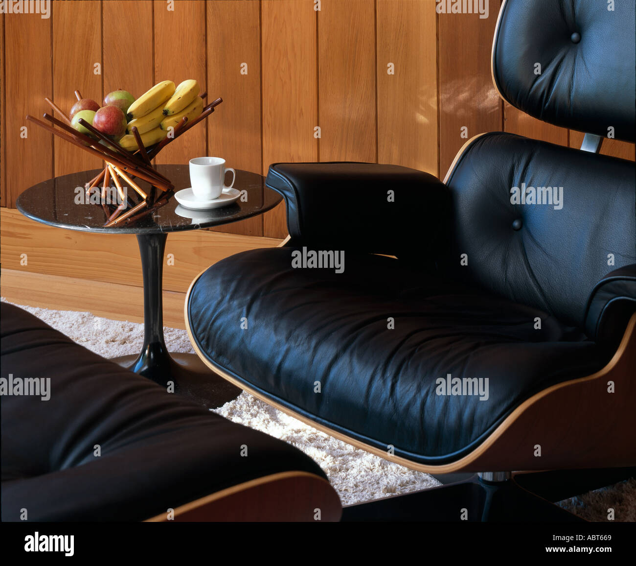 Space House, East Grinstead, West Sussex, detail of Eames Lounge Chair, 1956, in living area. Stock Photo