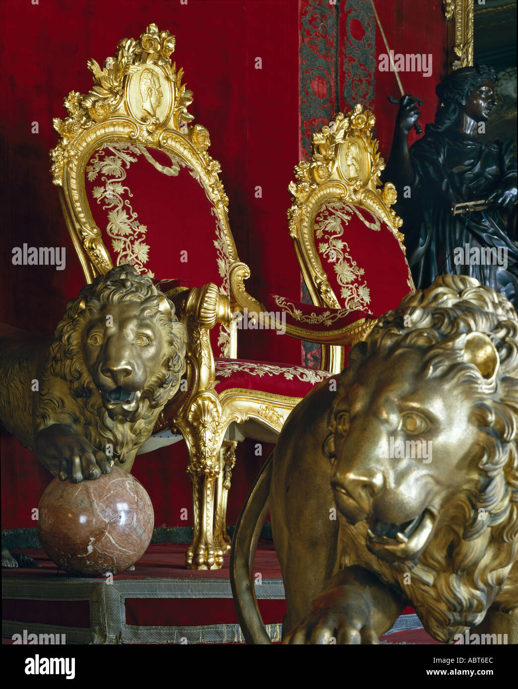 Royal Palace, Madrid. Louis XV style thrones between golden lions in the throne room. - Stock Image