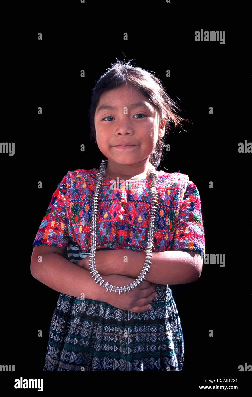 Portrait of a young Maya girl in traditional stlye costume of her community San Pedro Sacatepequez Guatemala Central America - Stock Image